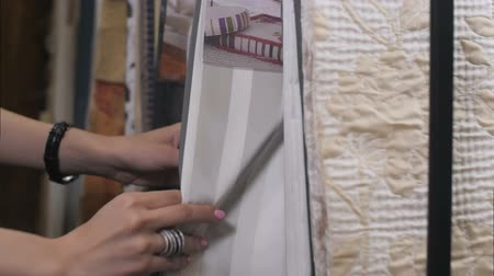 племенной : Interior designer in his studio shows fabric samples Стоковые видеозаписи