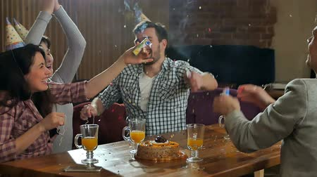 firecracker : Cheerful students with confetti celebrating birthday party in a cafe Stock Footage