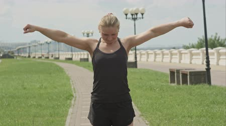 weight training : Woman warming up outdoors