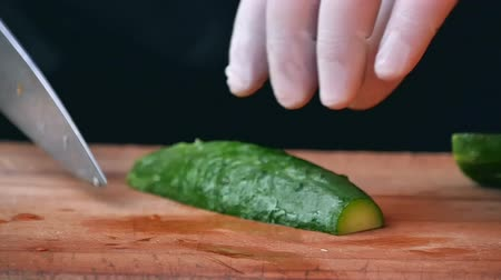 vegetarianismo : Cutting cucumber in the kitchen
