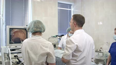 yara : Team of doctors using endoscopic equipment during operation