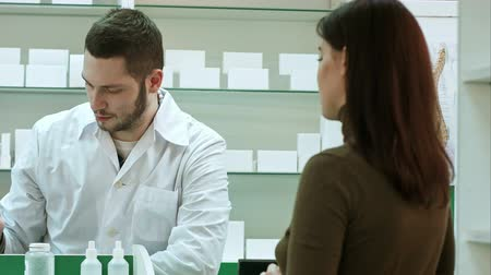 boticário : Male pharmacist and female client at pharmacy