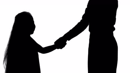 apologize : Silhouette Daughter and mother hand shake track matte Stock Footage