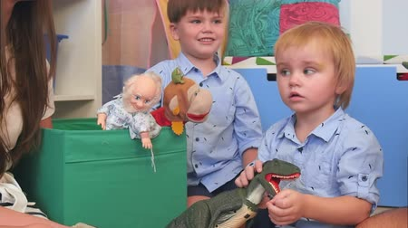 marionet : Two baby boys playing with toys in their nursery room Stockvideo