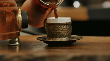 kuchenka : Coffee poured in a cup from the Turks