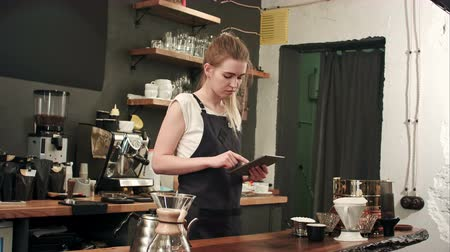 employed : Happy barista or waiter in apron with tablet pc computer at bar or coffee shop