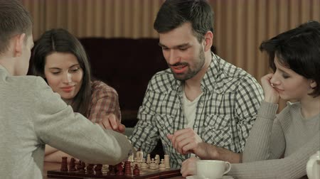 ロジック : Friends spending time playing chess 動画素材