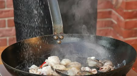 shellfish dishes : Cooking seafood in a pan with olive oil and parsley Stock Footage