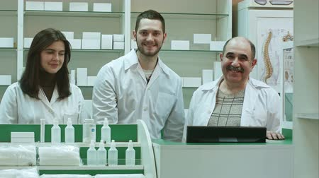 apotheker : Portrait of a pharmaceutical team smiling and looking at camera
