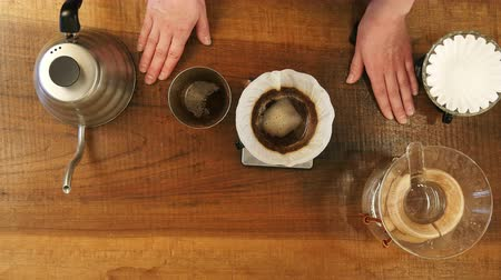 brew coffee : Hot water pouring trough coffee powder in the filter Stock Footage
