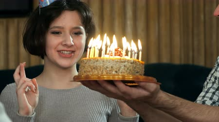temyiz : Young girl blowing candles on birthday cake