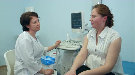 sonography : Young woman telling female doctor about her symptoms
