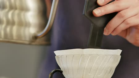 brew coffee : Barista prepare filtered coffee Stock Footage