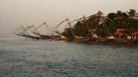 cochin : Sunrise over Chinese Fishing nets and boat in Cochin, India