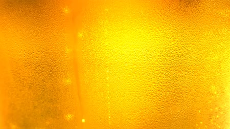 cidra : UHD macro of the glass of beer as a background