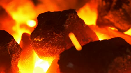 heating up metal : Blacksmithing: macro of the coal forge in UHD