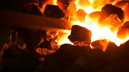 heating up metal : Heating up of the steel rod with a coal forge slow motion