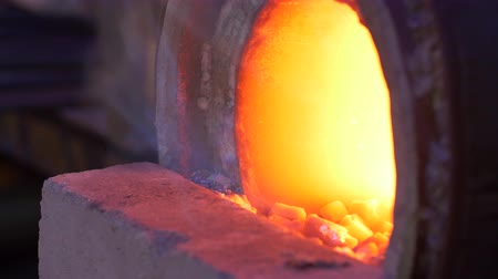 heating up metal : UHD closeup shot of the burning gas forge at blacksmith shop Stock Footage