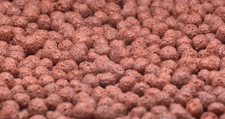 granola : C4K closeup shot of the chocolate cereal balls on a turntable Stock Footage