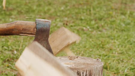 tűzifa : Chopping firewood by the axe in slow motion Stock mozgókép