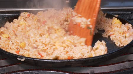 seafood dishes : UHD closeup shot of the rice being stir fried with an egg, shrimps and vegetables