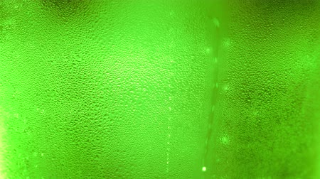 refresco : UHD macro of the green bottle of beer as a background Stock Footage