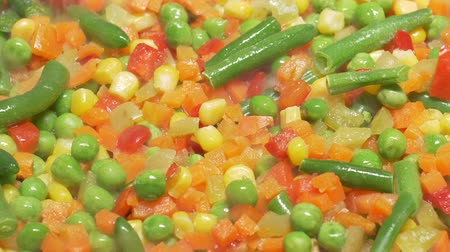 green peas : Closeup 1080p dolly of the vegies in a fry pan Stock Footage