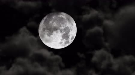 lunar surface : UHD shot of the moon with 3D animated realistic clouds