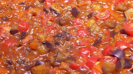 picado : Healthy food: frying eggplant, carrot and tomatoes in UHD
