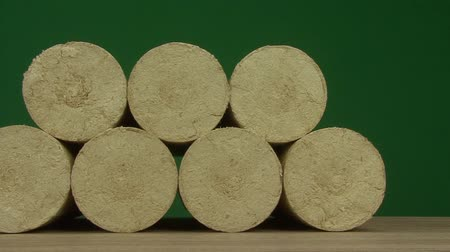preslenmiş : Wood sawdust briquettes straightened, green screen background. Alternative fuel, bio fuel. Slider shot