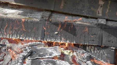 kurşun : Burning wooden military crates from ammunition. Burning fire. The smoldering fireplace Stok Video