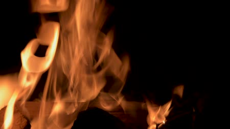 Burning flames at night. Fireplace with burning wood. Fire on a black background.