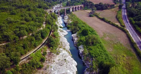 aerial cinematic flight over a river between rocks in Corsica nature Stock mozgókép