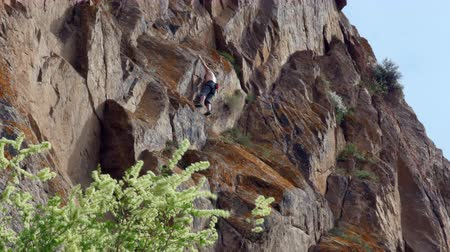 markolat : Man climber hiking and climbing the rock
