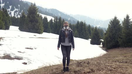bad ecology : Girl in gas mask standing in nature. Winter, snow, gasmask Stock Footage
