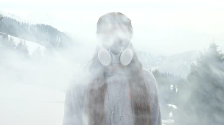 Girl is protected from bad air and smoke in a gas mask Wideo