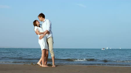 Romantic couple kissing on the beach at sea