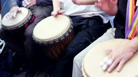 Group of Musicians Playing In Slow Motion On African Skin Covered Djembe. Hands