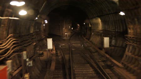 kijev : Train goes through a subway tunnel.