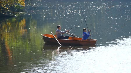 göl : KYIV, UKRAINE - SEPTEMBER 05,2014:Father and son fishing together on lake in Pushcha-Vodytsia