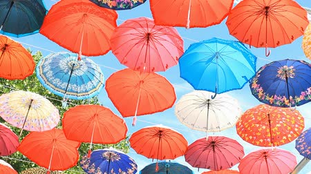 parasol : Multicolored umbrellas against the blue sky in Kemer,Turkey Stock Footage