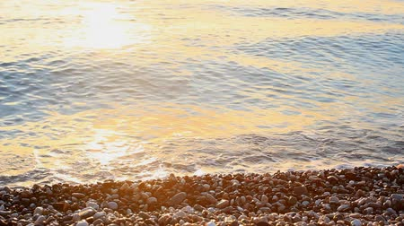 török : Sea with pebbles splashing at sunrise in Antalya