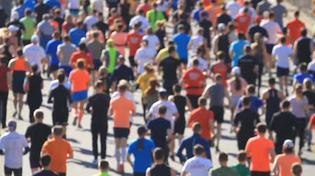 City marathon of running people in blurred Stock Footage