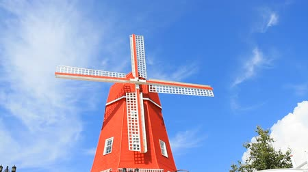 antalya : Red windmill against the blue sky Stock Footage