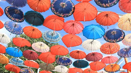 nejlon : Decorative umbrellas hanging against the blue sky