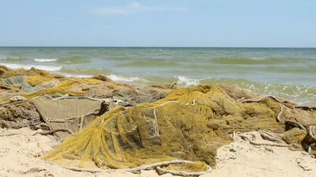Fishing nets by the sea with waves