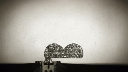 namoro : Red Heart drawn with the letters of the typewriter Stock Footage