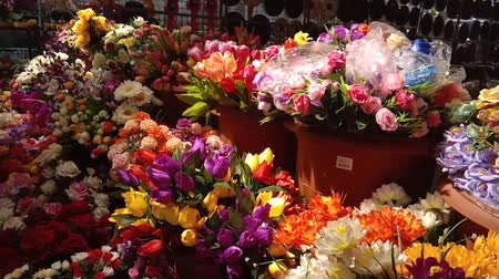 supermarket food : Toy flowers are sold in supermarkets Stock Footage