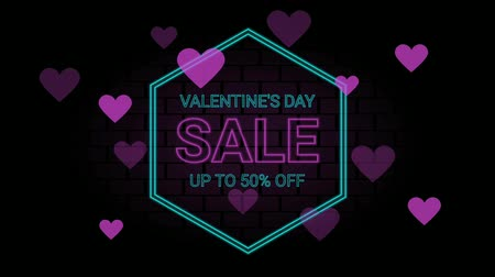 promover : Valentines day sale neon letter and heart symbol on the black color for promotion sale and for clearance sale and for promote sale season. Stock Footage