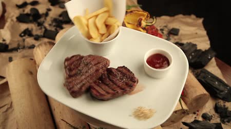 alecrim : Steak with fries and sauce on firewoods